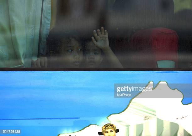 Children of former Citizens Gerakan Fajar Nusantara were in the shuttle bus after descending from the KRI Teluk Banten 516 at naval base Kolinlamil...