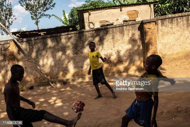 Children of genocide survivors play football inside a reconciliation village on April 06 2019 in Mbyo Rwanda The villages are home to both...