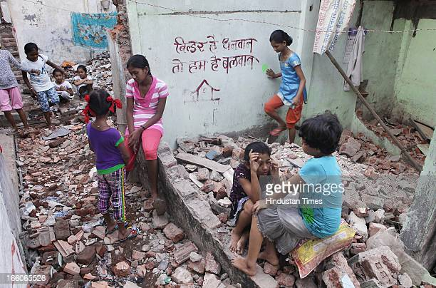 Children of Golibar Maidan a cluster of slums located along the Western Express highway between Santa Cruz and Khar in their demolished houses as...