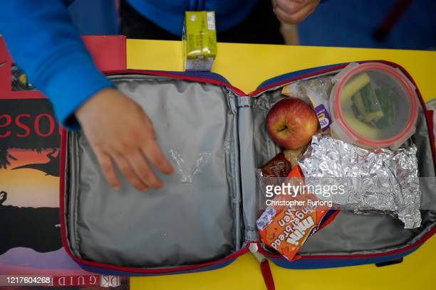 Children of key workers eat their packed lunches as attend school activities at Oldfield Brow Primary School on April 08 2020 in Altrincham England...