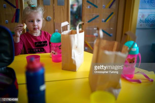 Children of key workers eat their packed lunches as attend school activities at Oldfield Brow Primary School on April 08, 2020 in Altrincham,...