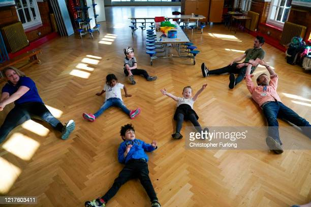 Children of key workers take part in a Joe Wickes exercise class during school activities at Oldfield Brow Primary School on April 08 2020 in...