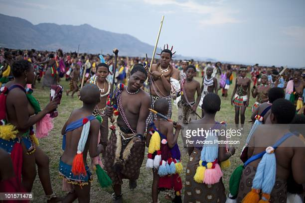 Children of King Mswati III dances in front of young virgins at a traditional Reed dance ceremony at the stadium at the Royal Palace on August 30 in...