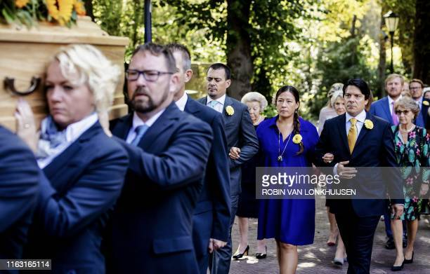 Children of late Princess Christina, Bernardo Guillermo , Juliana Guillermo and Nicolas Guillermo attend the funeral of their mother with other...