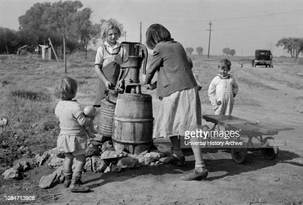 Children of Migrant Workers Fetching Water, American River Migrant Camp, San Joaquin Valley, California, USA, Dorothea Lange, Farm Security...