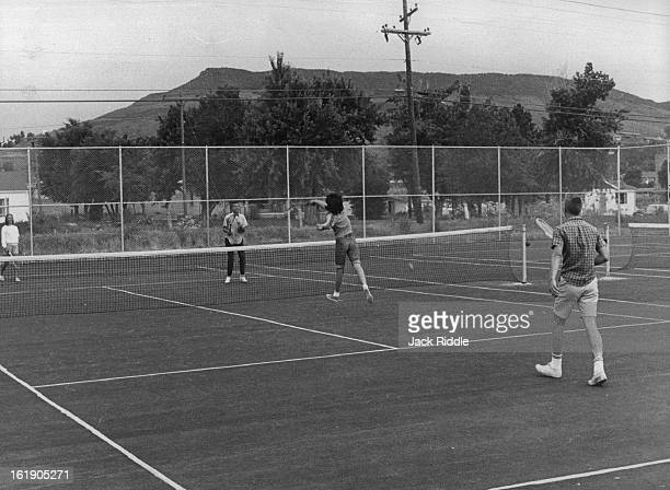 JUN 18 1962 JUL 4 1962 Children of Rolling Hills Country Club members try out the new asphalt tennis courts dedicated last week at the 240 acre club...