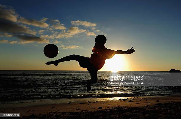 Children of the MCB Sports Academy enjoy a game of football at the Mauritius Resort on May 28 2013 in Port Louis Mauritius