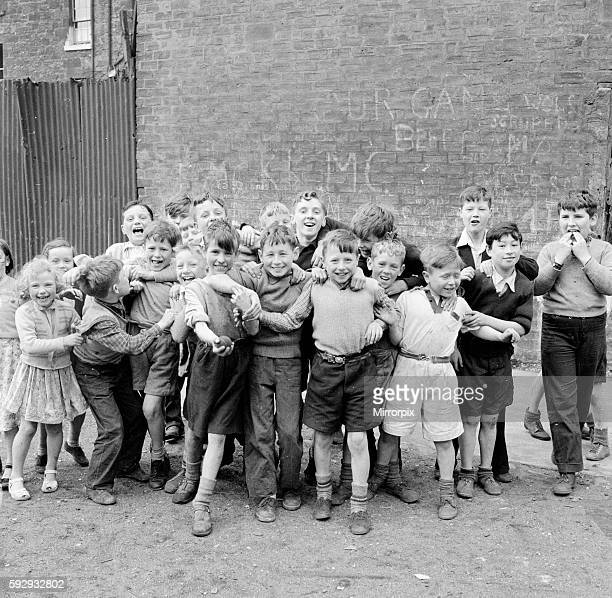 Children of the tenement blocks of Govan, Glasgow seen here posing for the camera following a game of street cricket. September 1956