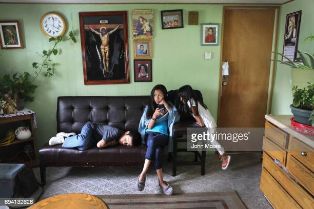 Children of undocumented immigrant activist Jeanette Vizguerra visit a friend's house on June 6 2017 in Denver Colorado Vizguerra was given a...