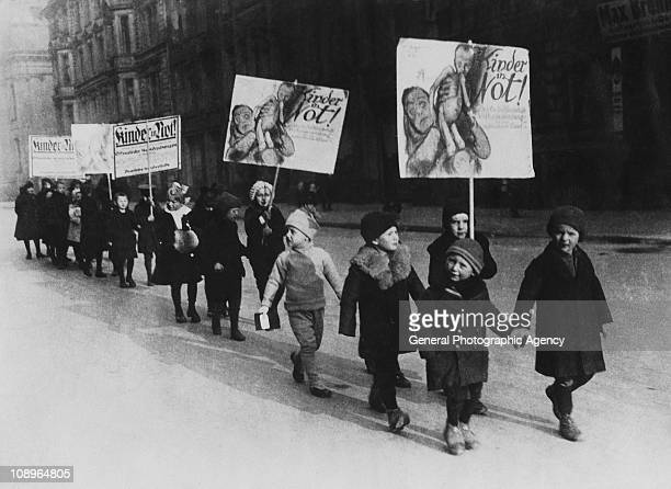 Children of wealthy parents march in Berlin to highlight the extent of poverty among the city's children circa 1930 Their placards read 'Kinder In...