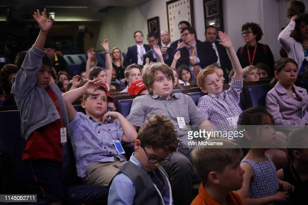 Children of White House staff and reporters ask questions during a briefing by White House press secretary Sarah Sanders on April 25 2019 in...