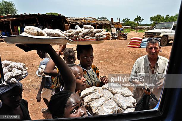 CONTENT] Children offering peanuts to travelers Mali 2009