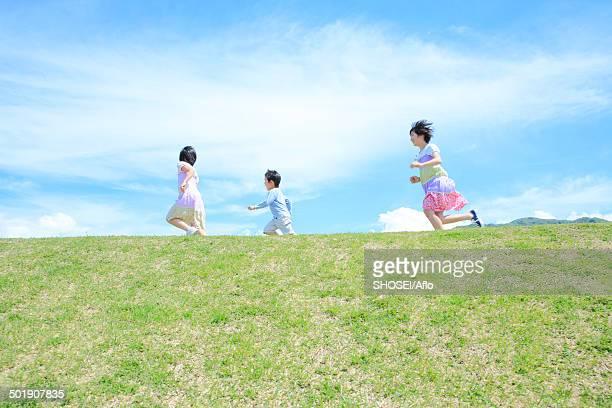 Children on a hill, Japan
