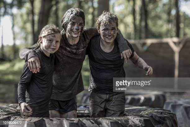 children on a mud run - military training stock pictures, royalty-free photos & images