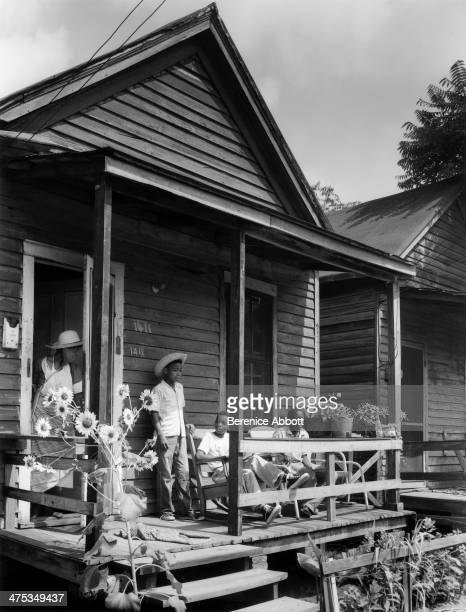 Children on a porch with Sunflowers 1411 9th Street Augusta Georgia United States 1954