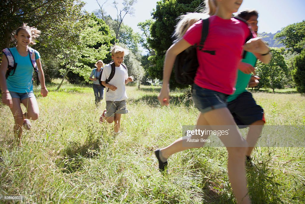Children on a school field trip in nature : Stock Photo