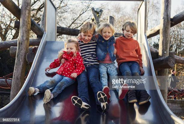 Children on a slide in the park