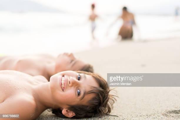 Children on beach sand