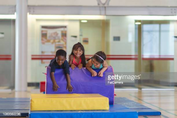Children on gym landing pads