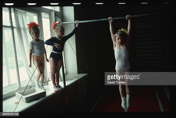 Children on High bar
