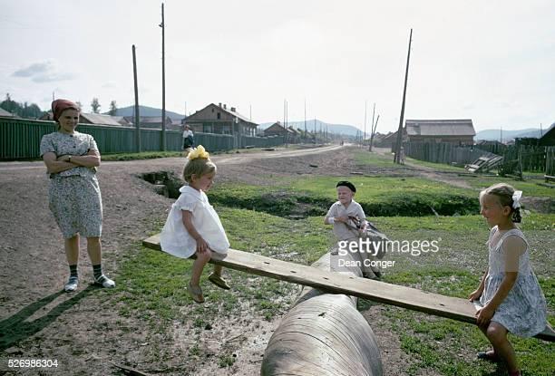 Children on HomeMade Seesaw