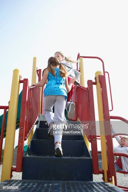 children on playground equipment - climat stock pictures, royalty-free photos & images