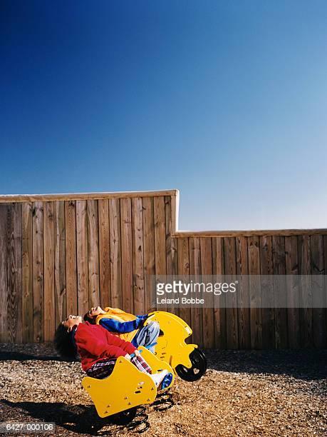 Children on Playground Ride