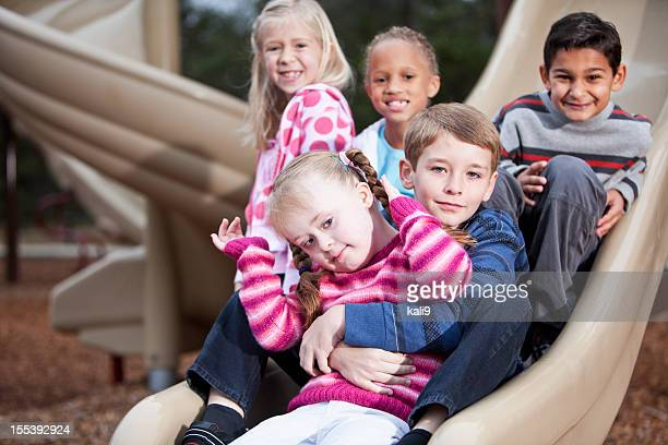 Children on playground slide