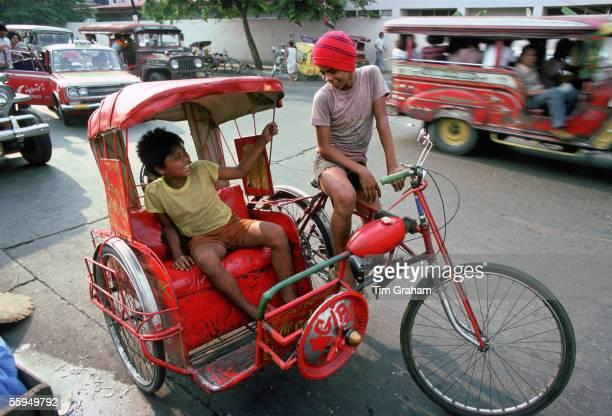 Children on rickshaw Manila Philippines