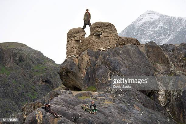 children on rocks - afghanistan stock pictures, royalty-free photos & images