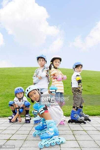 Children on rollerblades, portrait