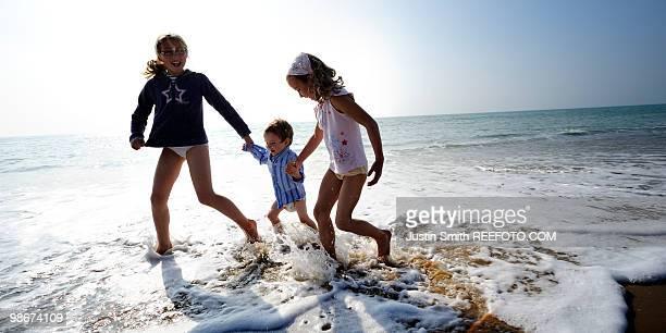 Children on the beach running
