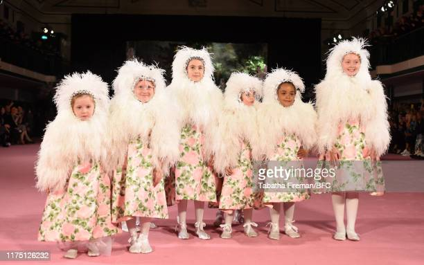 Children on the runway at the Richard Quinn show during London Fashion Week September 2019 at York Hall on September 16, 2019 in London, England.