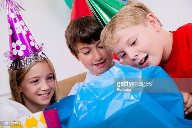 Children Opening Birthday Presents