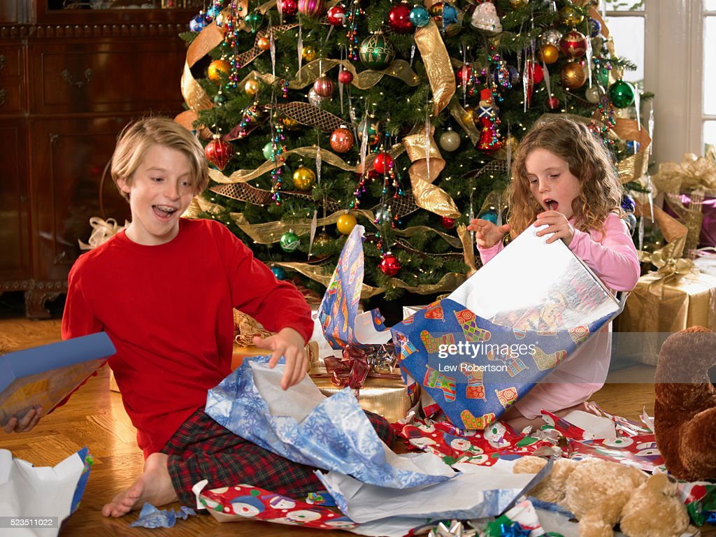 Children Opening Christmas Presents Stock Photo | Getty Images