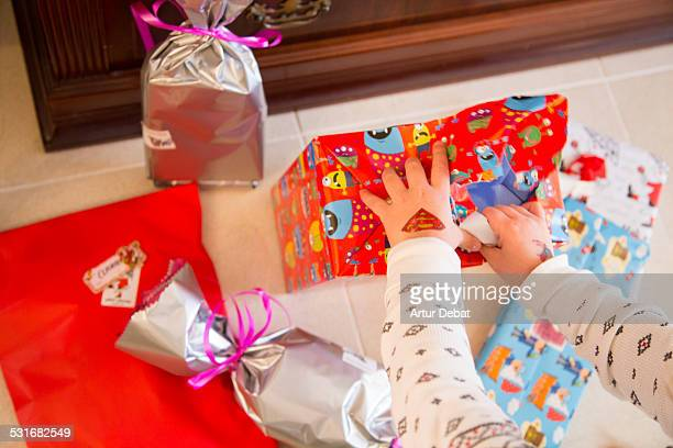 Children opening his presents on the morning of the Three Kings Day for the January 6th of 2015 in Barcelona Catalonia Europe