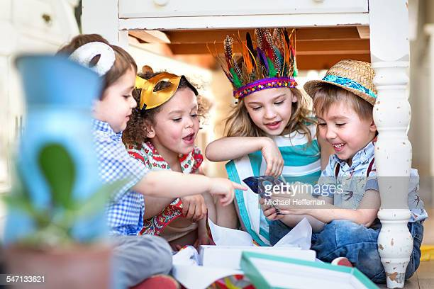 children opening presents at party - opening party stock photos and pictures