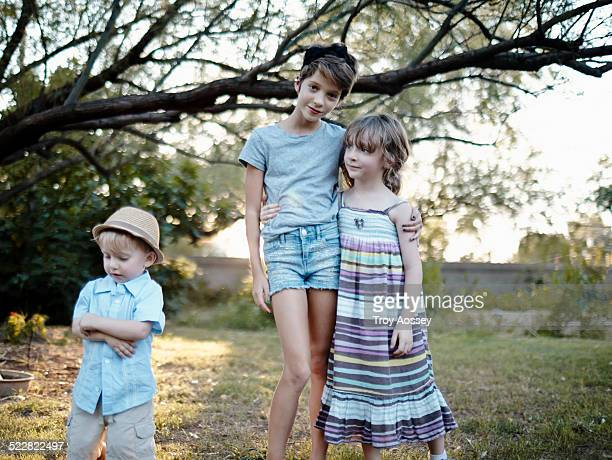 children outdoors casually looking at camera