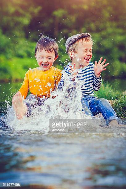 children outdoors - spring flowing water stock pictures, royalty-free photos & images