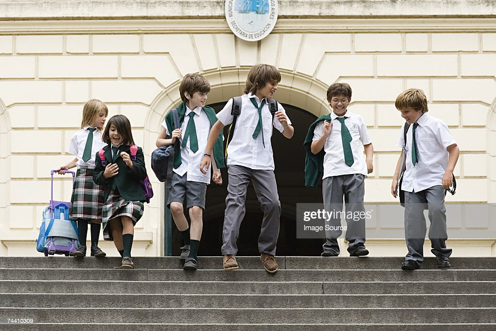 Children outside of school : Stock Photo