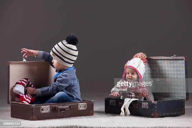 Children packing for travel