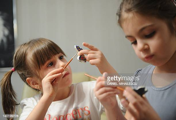 Children paint butterflies during a martisor workshop organized by a company for the children of employees in Bucharest February 22 2012 Every March...