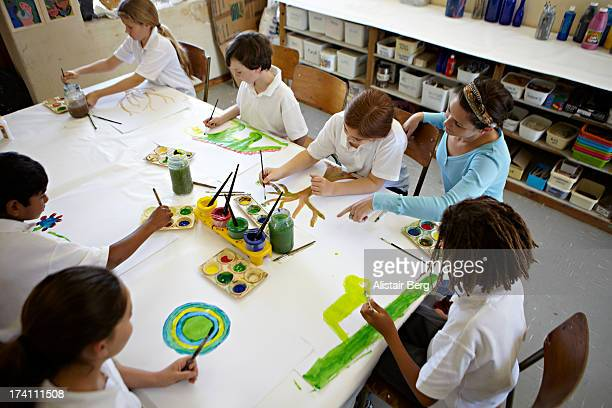 Children painting at school