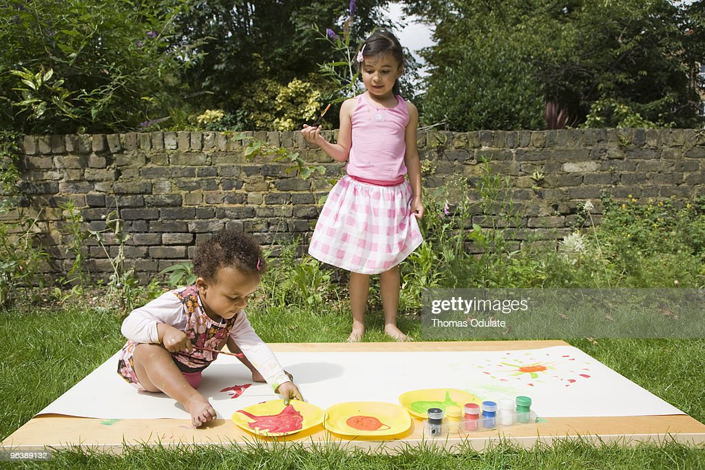 Children Painting in the garden : Stock Photo