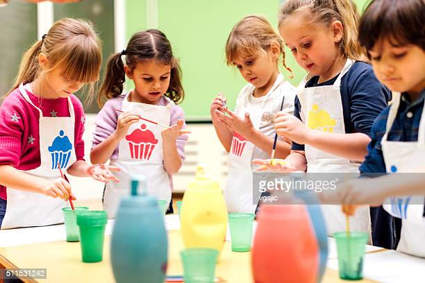 Children Painting Their Hands With Watercolors.