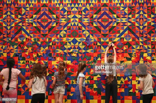 Children paly with colour and shape using velcro swatches at an installation by the Dutch art collective 'We Make Carpets' during a media preview of...