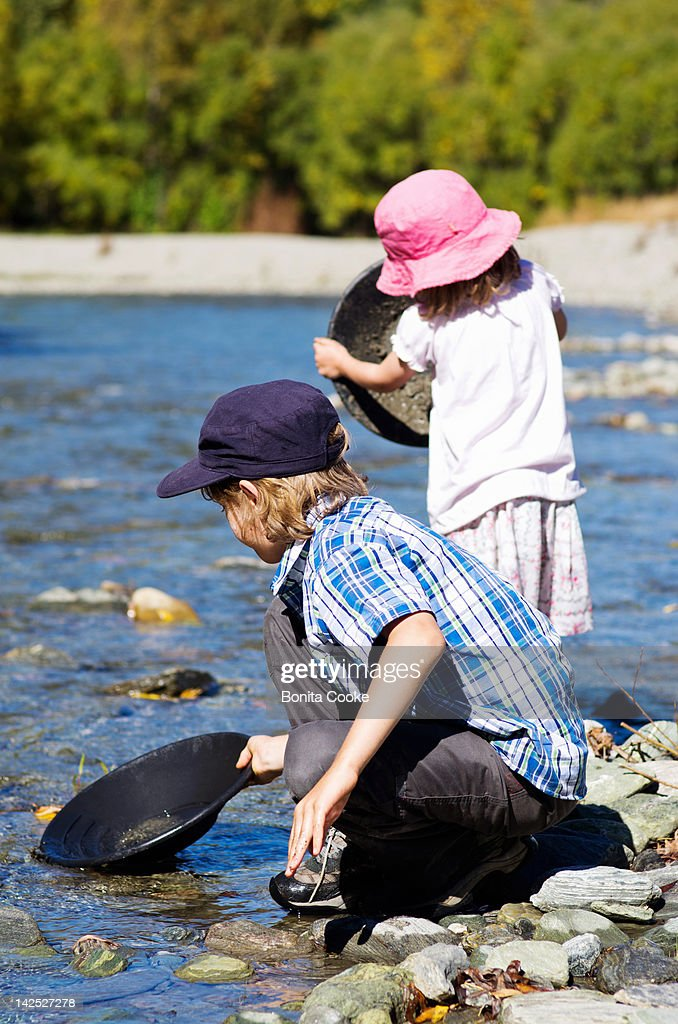 Children panning for gold : Stock Photo
