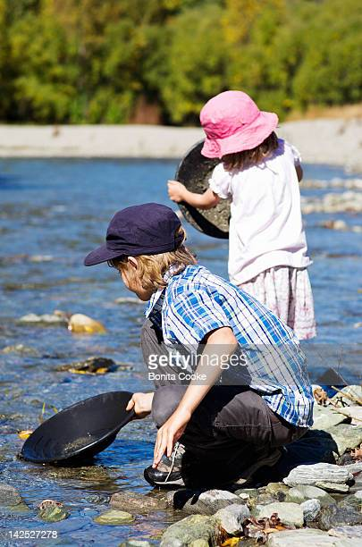 children panning for gold - gold rush stock photos and pictures