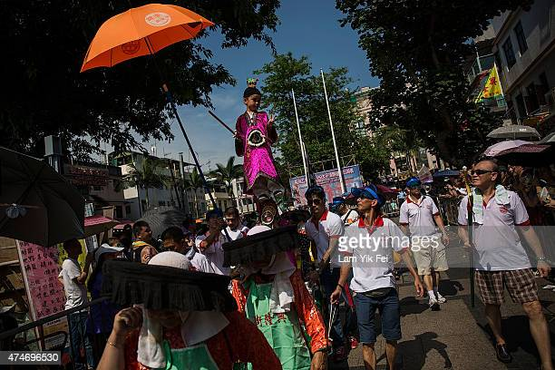 Children parade on a float during the Bun Festival on May 25 2015 in Hong Kong Hong Kong One of Hong Kong's most colourful cultural celebration event...