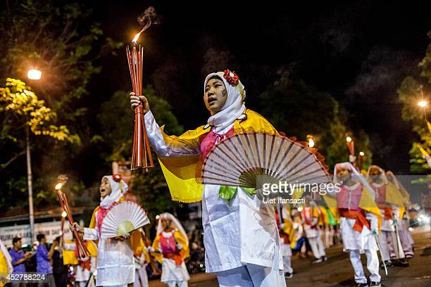Children parade on the streets as Muslims celebrate ahead of Eid AlFitr on July 27 2014 in Yogyakarta Indonesia Muslims will celebrate Eid alFitr on...